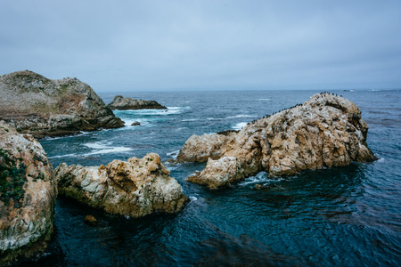 ocean state: Massive rocks in the Pacific Ocean, at Point Lobos State Natural Reserve, California. Stock Photo
