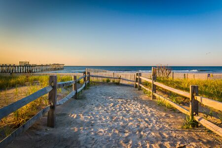 Path over sand dunes to the Atlantic Ocean at sunrise in Ventnor City, New Jersey.