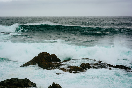 ocean state: Waves and rocks in the Pacific Ocean, seen at Garrapata State Park, California.