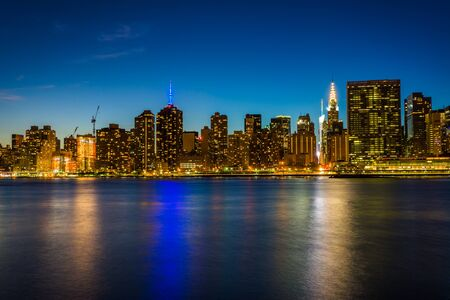 long exposure: View of the Manhattan skyline at night, from Gantry Plaza State Park, in Long Island City, Queens.