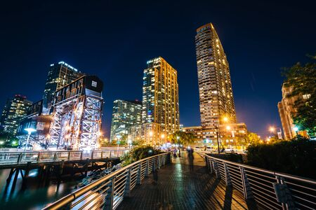 long island: Walkway and Long Island City at night, seen from Gantry Plaza State Park, Queens, New York. Editorial