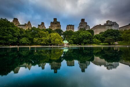 conservatory: Buildings reflecting in the Conservatory Water in Central Park, in Manhattan, New York.