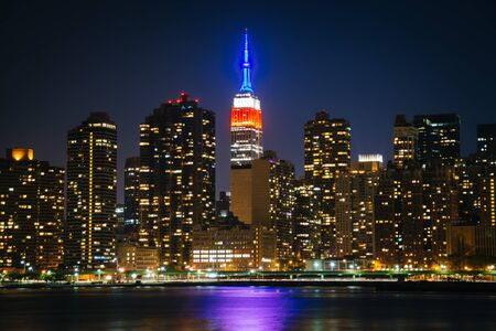 long: View of the Empire State Building from Gantry Plaza State Park, in Long Island City, Queens, New York.