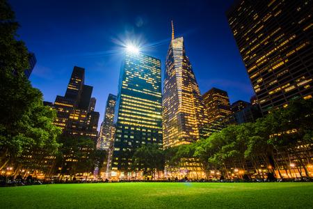 bryant park: Skyscrapers in Midtown at night, seen at Bryant Park in Manhattan, New York.
