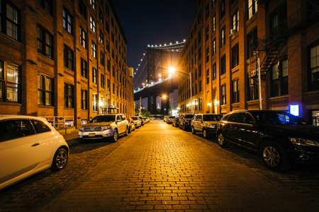Washington Street and the Manhattan Bridge at night, in Brooklyn, New York.