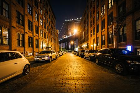 Washington Street and the Manhattan Bridge at night, in Brooklyn, New York.