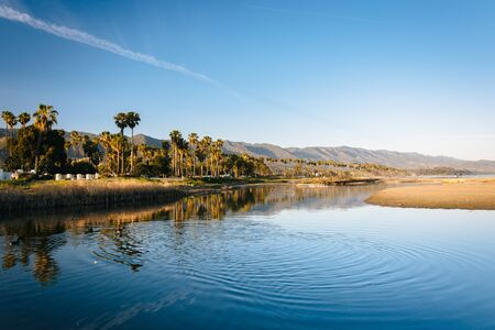 barbara: Palm trees and mountains reflecting in Mission Creek, in Santa Barbara, California. Stock Photo