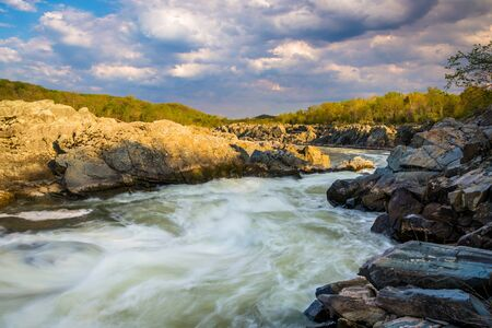 rapids: Evening light on rocks and rapids in the Potomac River, at Great Falls Park, Virginia.