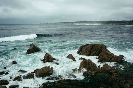 pebble beach: Rocks and waves in the Pacific Ocean, seen from the 17 Mile Drive, in Pebble Beach, California.