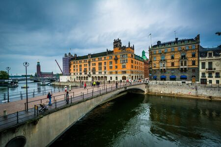 norrmalm: View of Riksbron and buildings in Norrmalm, from Helgeandsholmen, in Galma Stan, Stockholm, Sweden.