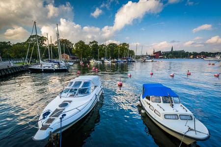 Boats docked at Kastellholmen, in Norrmalm, Stockholm, Sweden.