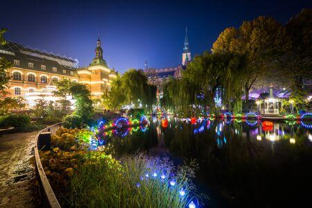 danmark: The lake at Tivoli Gardens at night, in Copenhagen, Denmark. Stock Photo