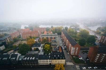 Foggy view from the tower of the Church of Our Saviour, in Christianshavn, Copenhagen, Denmark.