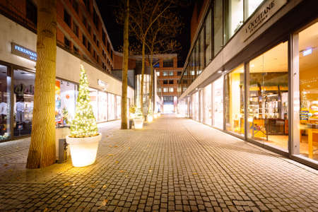 Christmas trees along a walkway at night in Munich, Germany. Stok Fotoğraf - 49299642