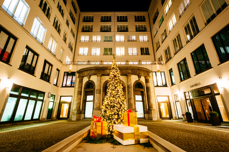 Christmas tree and buildings at night, in Munich, Germany. Editöryel