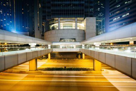 pedestrian bridges: Modern skyscrapers and pedestrian bridges at night, at Central, in Hong Kong Stock Photo