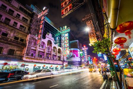 Neon lights and traffic on Yaowarat Road at night, in Chinatown, Bangkok, Thailand.