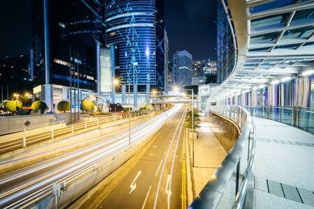 elevated walkway: Elevated walkway and long exposure of traffic on Garden Road at night, in Hong Kong Stock Photo