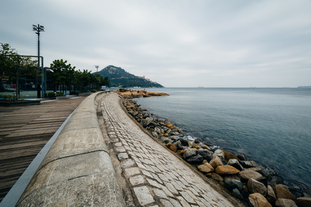 hong kong island: Rocky coast at Stanley, on Hong Kong Island, Hong Kong. Stock Photo