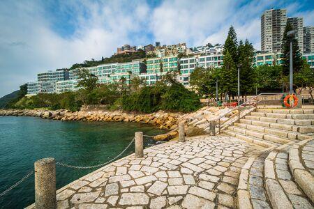 repulse: Pier and rocky coast at Repulse Bay, in Hong Kong, Hong Kong. Stock Photo