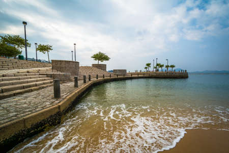 repulse: Beach and pier at Repulse Bay, in Hong Kong, Hong Kong. Stock Photo