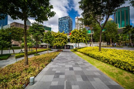 Walkway at a park and skyscrapers at Bonifacio Global City, in Taguig, Metro Manila, The Philippines.