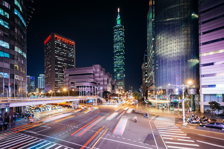 Traffic on Xinyi Road and view of Taipei 101 at night, in Taipei, Taiwan. Stock Photo