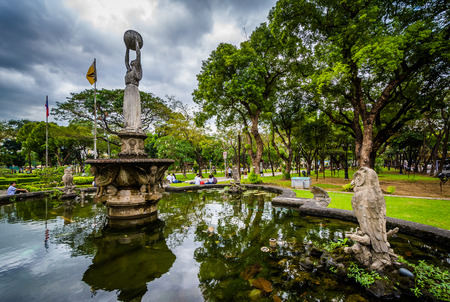 university fountain: Statues and fountain at the University of Santo Tomas, in Sampaloc, Manila, The Philippines. Stock Photo