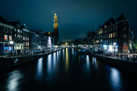 westerkerk: The Prinsengracht canal and Westerkerk at night, in Amsterdam, The Netherlands. Stock Photo