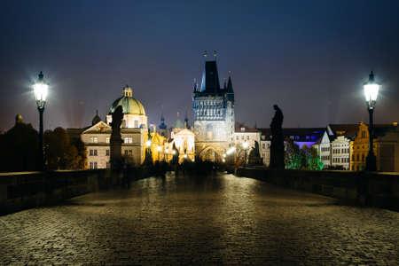 The Charles Bridge at night, in Prague, Czech Republic. Reklamní fotografie