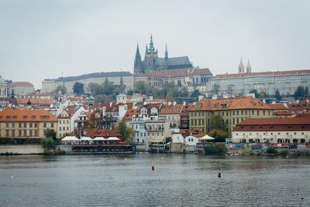 The Vltava and buildings in Malá Strana, in Prague, Czech Republic.