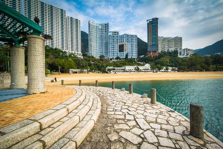 repulse: Pier and skyscrapers at Repulse Bay, in Hong Kong, Hong Kong. Stock Photo