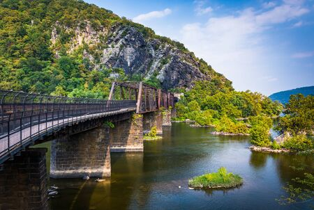 west river: Bridge over the Potomac River and view of Maryland Heights, in Harpers Ferry, West Virginia. Stock Photo