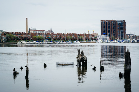 fells: Pier pilings and waterfront buildings in Canton, Baltimore, Maryland.