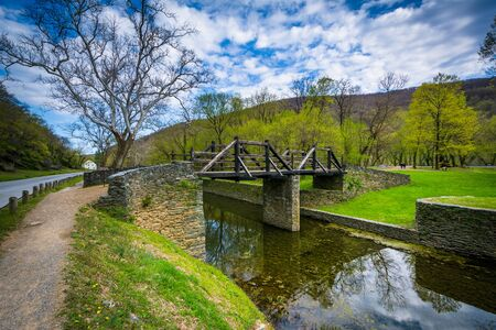west virginia trees: Wooden bridge over the Shenandoah Canal, in Harpers Ferry, West Virginia.