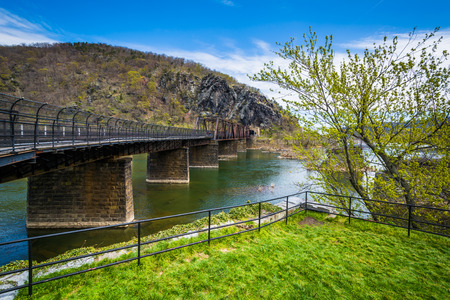 west virginia trees: Old bridge over the Potomac River, in Harpers Ferry, West Virginia.