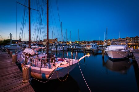 fells: Boats in a marina at twilight, in Fells Point, Baltimore, Maryland. Stock Photo