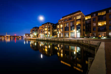 fells: The full moon over a waterfront apartment building in Fells Point, Baltimore, Maryland.