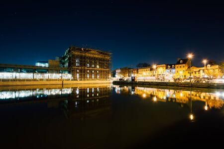 fells: Buildings on the waterfront in Fells Point at night, in Baltimore, Maryland. Stock Photo
