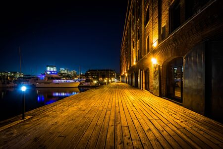 fells: Hendersons Wharf at night, in Fells Point, Baltimore, Maryland.
