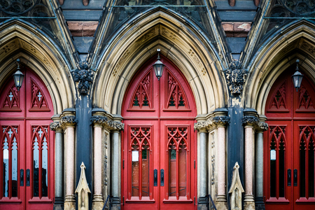methodist: The red doors of Mount Vernon Place United Methodist Church, in Mount Vernon, Baltimore, Maryland. Stock Photo