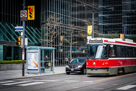king street: Streetcar and modern buildings at the intersection of Simcoe Street and King Street in downtown Toronto, Ontario.