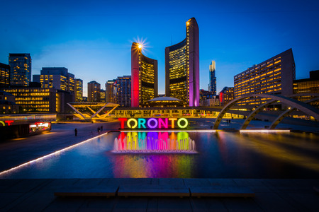 View of Nathan Phillips Square and Toronto Sign in downtown at night, in Toronto, Ontario. Redakční