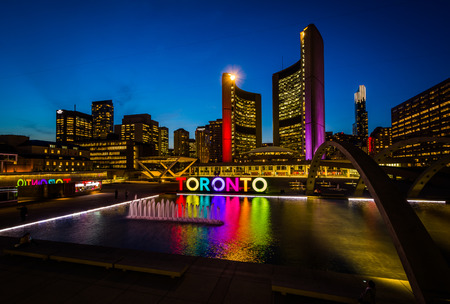 View of Nathan Phillips Square and Toronto Sign in downtown at night, in Toronto, Ontario. Editorial