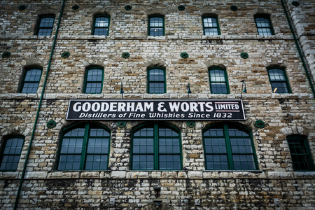Historic stone building and sign in the Distillery Historic District, In Toronto, Ontario. Editorial