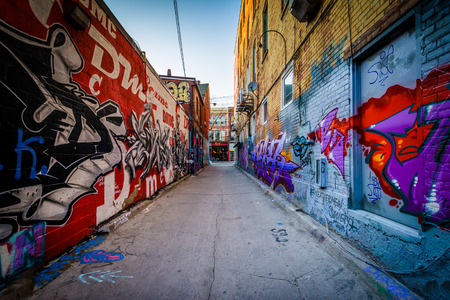 building wall: Street art in Graffiti Alley, in the Fashion District of Toronto, Ontario. Editorial