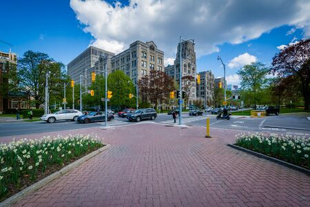 Garden at Queens Park, and the intersection of Queens Park Crescent and Wellesley Street, in Toronto, Ontario. Editorial