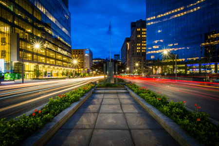 median: Gardens in the median of University Avenue, and modern buildings in the Discovery District at night, in Toronto, Ontario.
