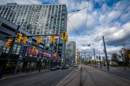 streetcar: Streetcar tracks and modern buildings along Queens Quay West, at the Harbourfront, in Toronto, Ontario.
