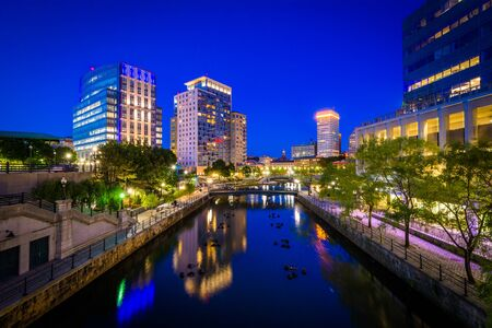 providence: The Providence River and modern buildings at night, in downtown Providence, Rhode Island.